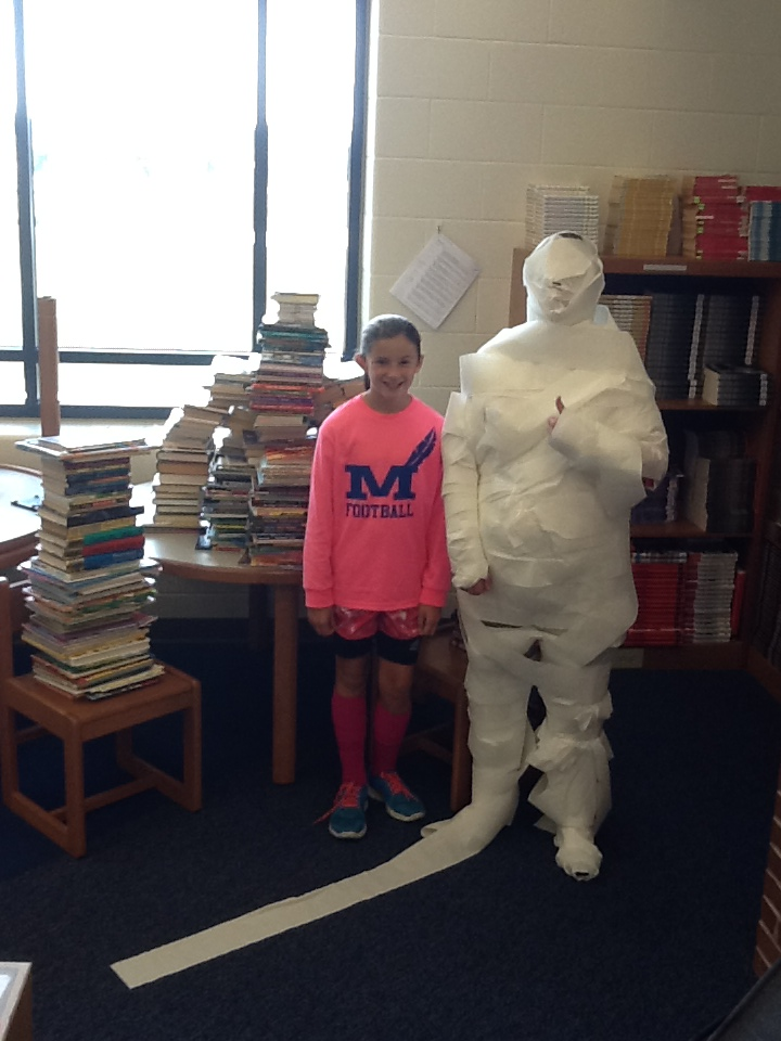MCIS reached their goal of having over 500 books donated, so Mrs. Woodford was mummified!