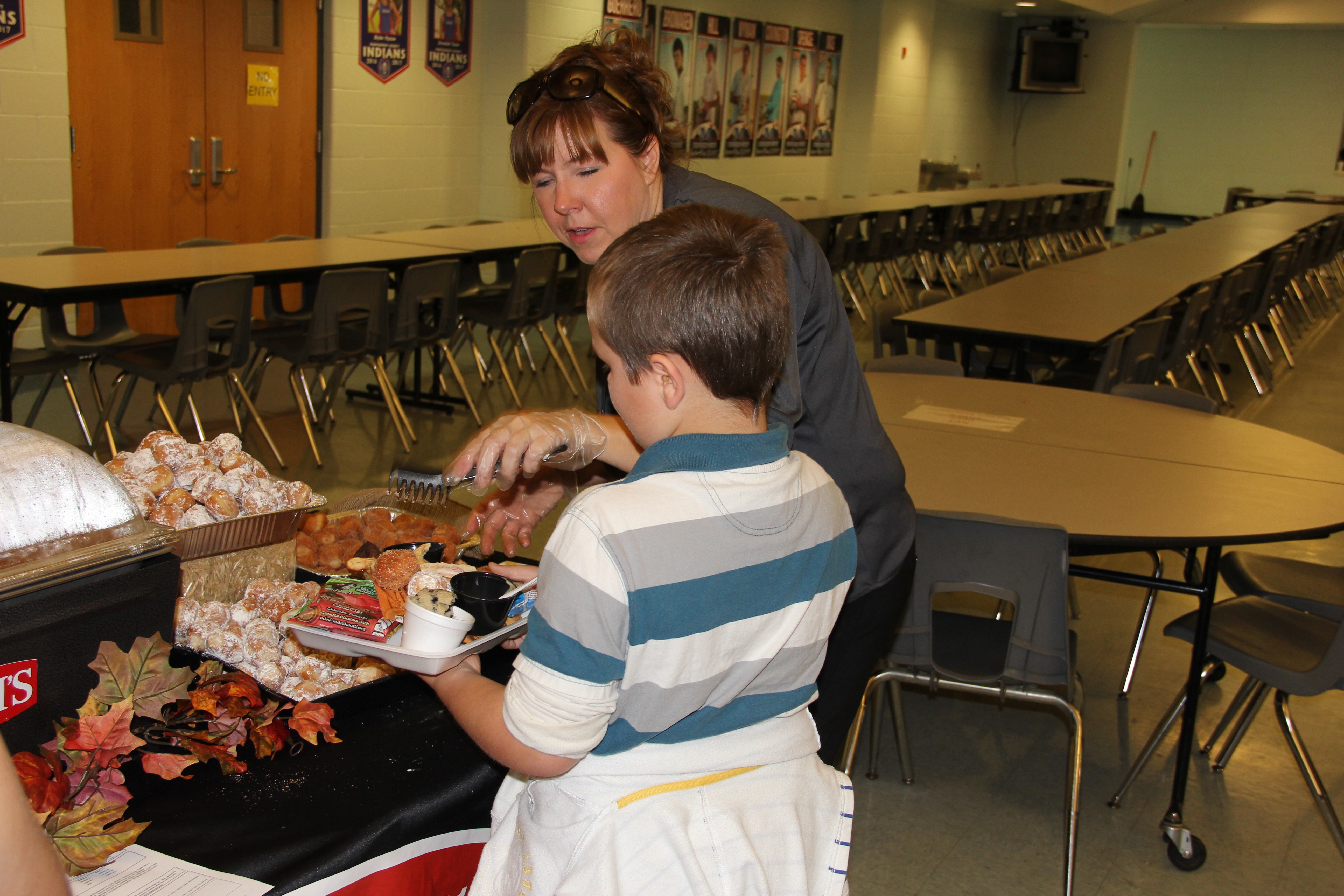 Student receives a variety of donut holes to taste during the District-Wide Menu Food Tasting.