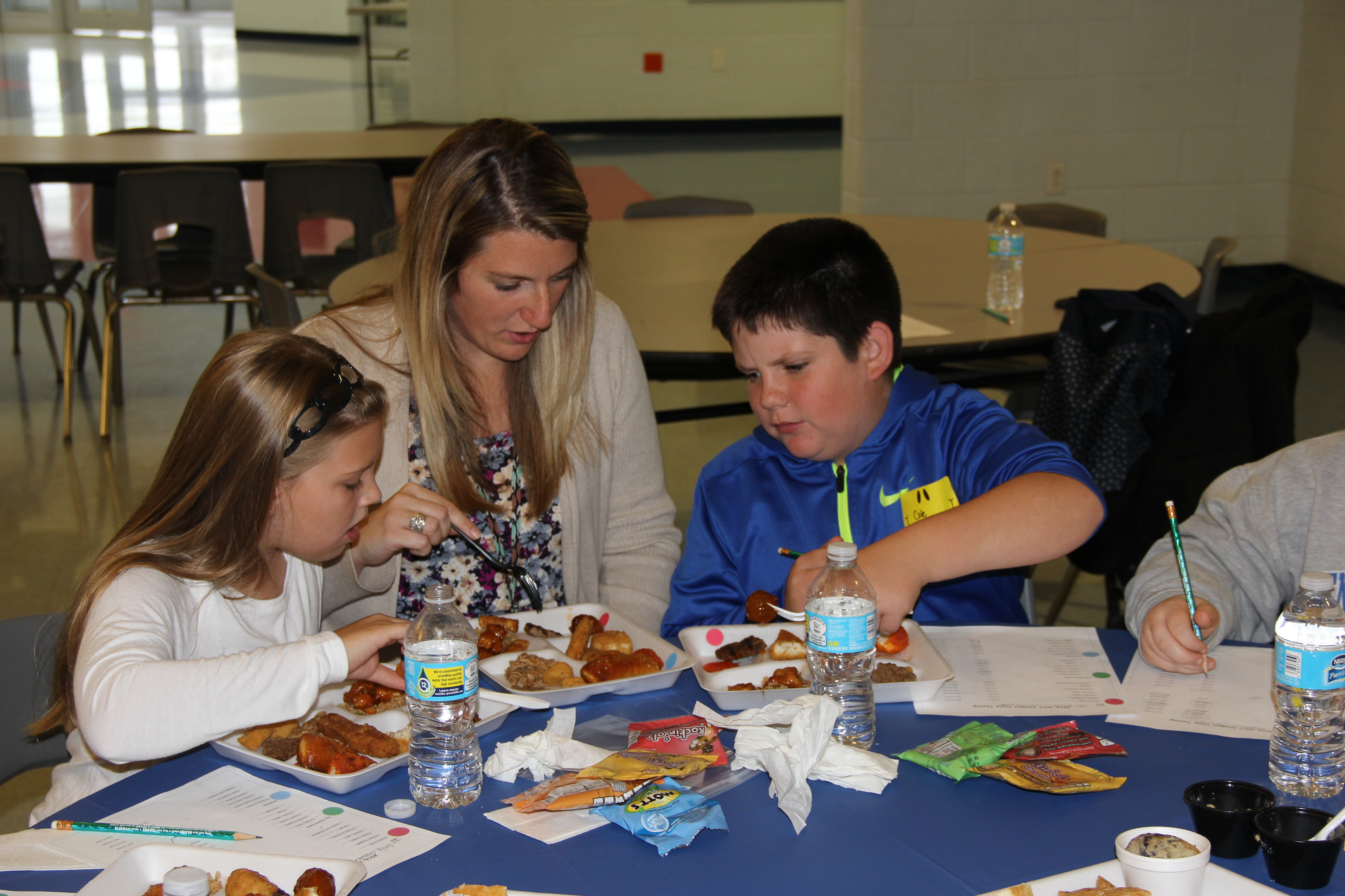 Camargo students and Mrs. David sampling a variety of foods at the District-Wide Menu Food Tasting.
