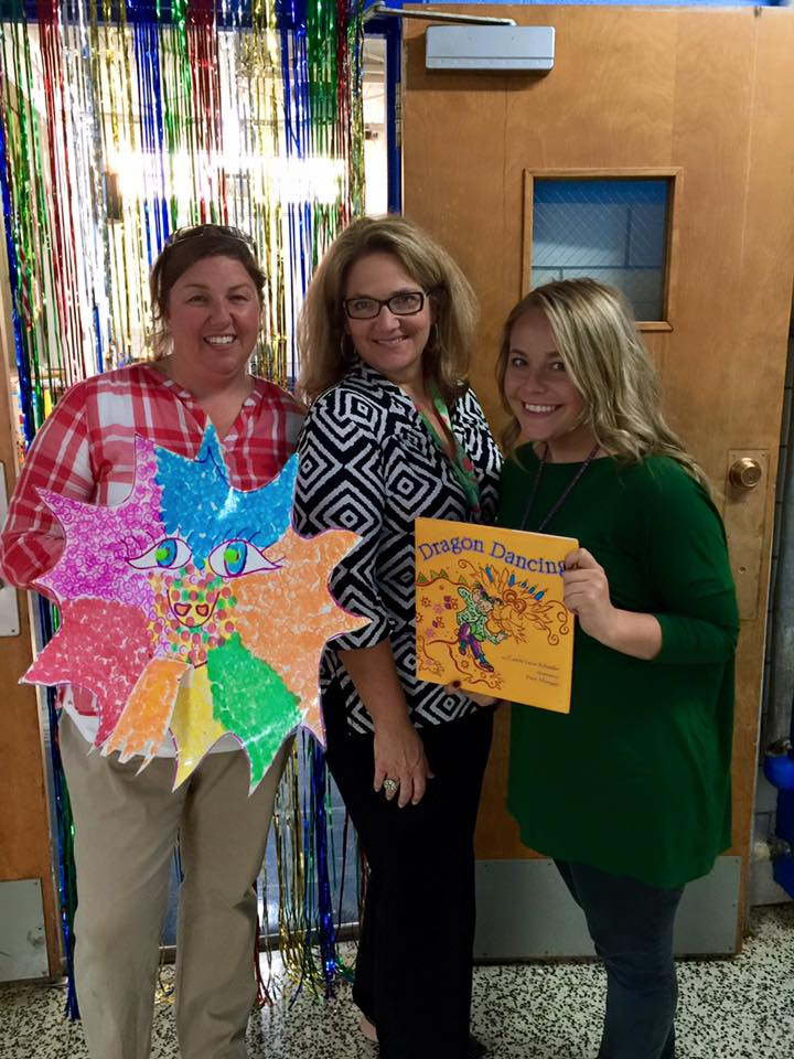 "Therapists Megan Turner, Marti Escalante, and Lindsey Sizemore with the book ""Dragon Dancing""."