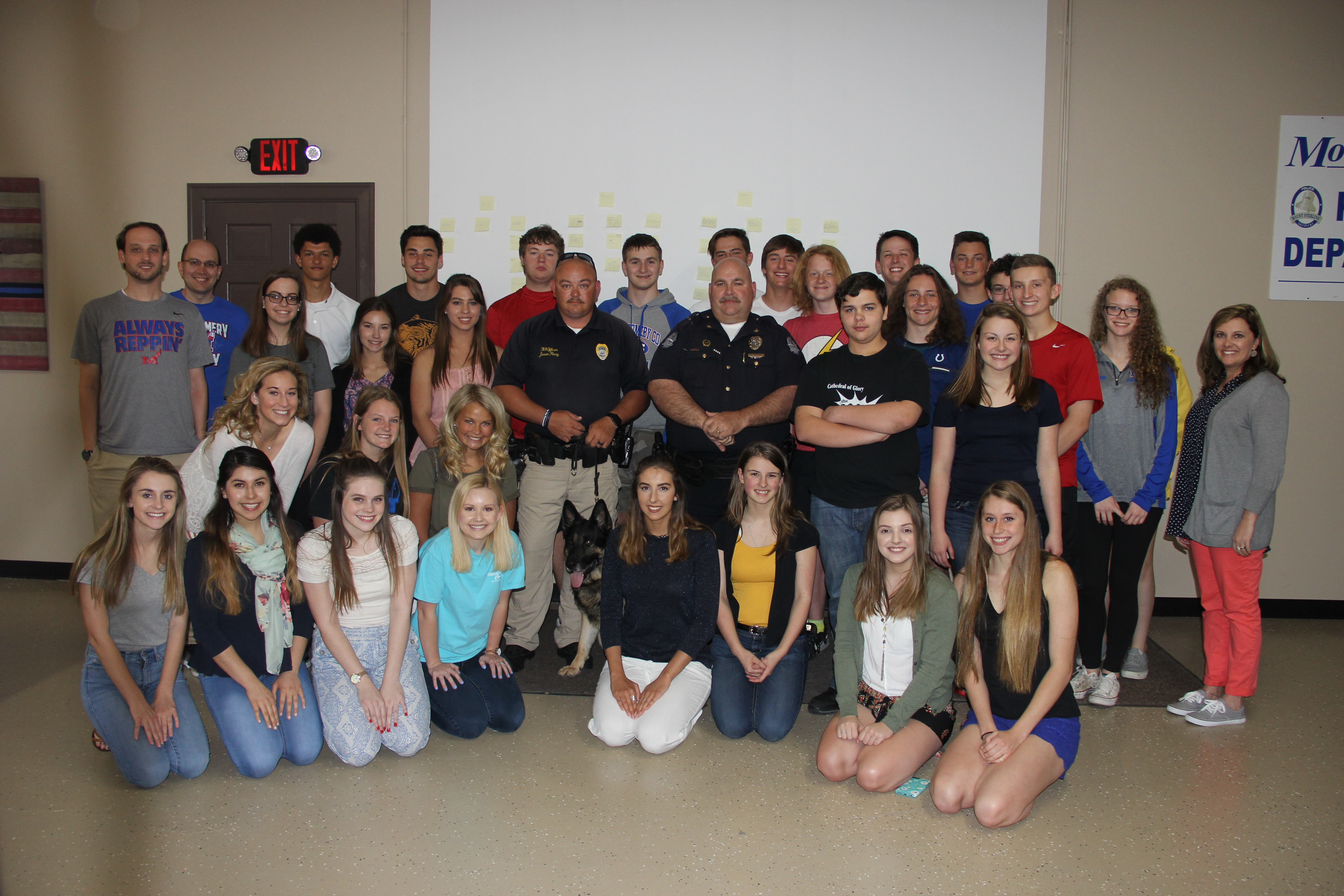 MCHS Youth ADAPT group with Chief Charles and K9 Officer Jason Perry.