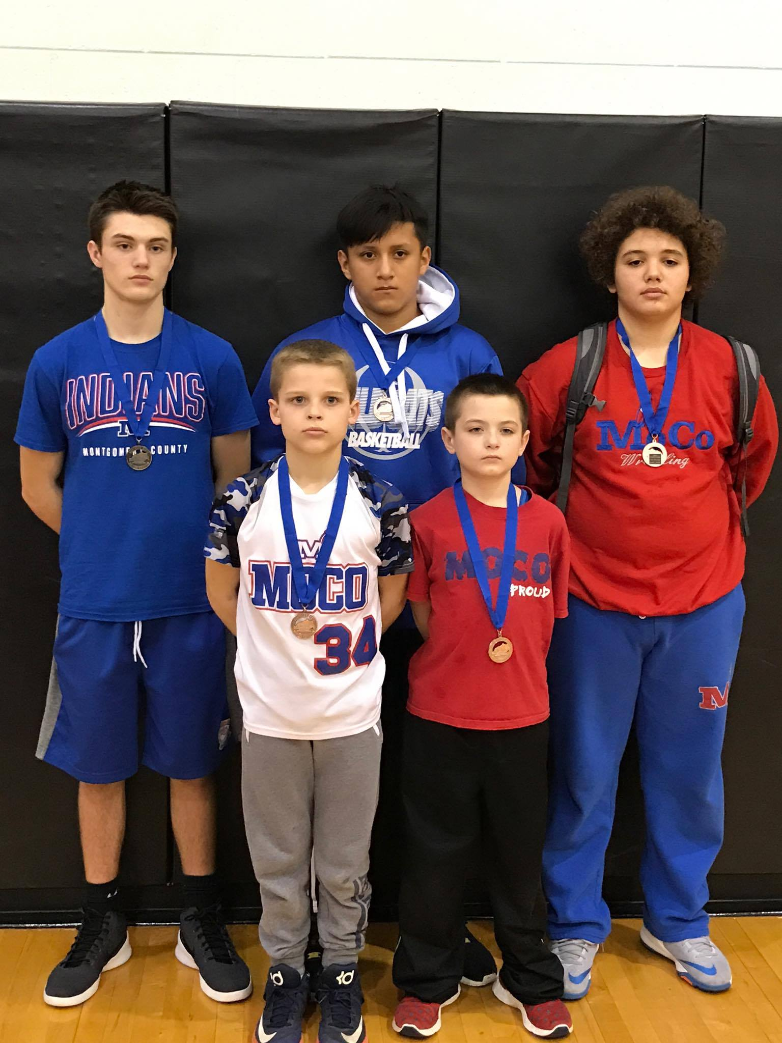 McNabb Wrestling Team finished 4th in district tournament.